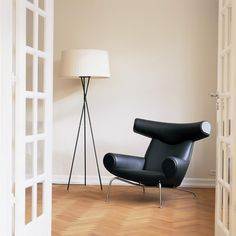 Designed by Hans Wegner in 1960, the Ox chair is regarded a modern classic. Unlike most of Wegner's wooden furniture design, the Ox chair is made of natural leather and chrome-plated steel legs. Due to the high level of craftsmanship and complex construction required to build the chair, production came to a stop until 1985 when Erik Jørgensen was contracted as manufacturer.  The robust sculptural form was inspired by Picasso's work. A footstool compliments the chair.  <strong>d...