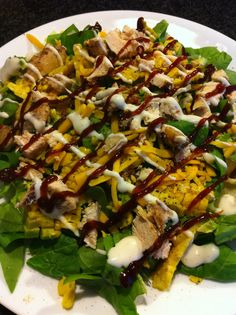 Homemade Cobb Salad: iceberg, spinach, corn on the cob shaved off, green onion, avacado, bacon bits, shredded chicken, chopped pecans, cheddar cheese, black pepper, lite ranch, and BBQ sauce.