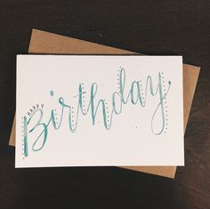 """A simple, hand-lettered birthday card. Digital reproduction of a hand lettered illustration. Specifications Material Speckletone White Cover Dimensions 4"""" x 6"""" Envelope Recycled brown kraft Features S"""