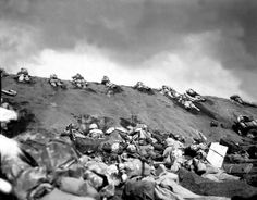 It must have resembled Hell, the 8 square miles of volcanic ash and sand, ground that tanks, let alone Marines, had to slog through. Reeking of sulfur and swept by bombs, bullets and shellfire, the beach was bloody of the 26,000 dead soldiers.  For the Corp, the Battle of Iwo Jima was the definitive battle in the Pacific. It was the bloodiest battle in history for the Corp. This high cost yielded more than 1/4 of the WW II Medals of Honor awarded to Marines .