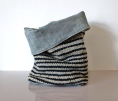 Knitted storage basket with woven lining.