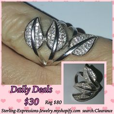 Magical leaves sit sideways on a band with micro pave cz's in a sterling silver setting.  Gorgeous ring!  Reg $80 - Clearance Close-out!