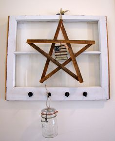 Remodeling an old house? Reuse an old window by putting hooks on it and hanging it on a wall and make a cute star from some lathe boards (the boards underneath the plaster in your walls). The stars would be adorable paired together in three's and spray painted one red one white and one blue!