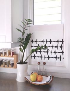 Great idea: use a stylish dish towel as a cafe curtain in the kitchen.