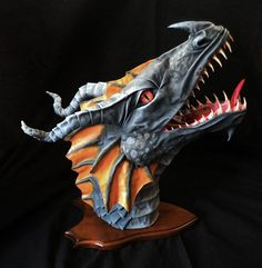Epic original fantasy art. Unique custom hand made ethical dragon trophy head sculpture, wall mounted, home decoration. Faux taxidermy made with paper mache, cloth / fabric mache, fimo (polymer and air-dry clay), horns, newspaper, cardboard, oak shield, acrylic paint, cotton sheets. Visit The Arcane Dragonry online for free tutorials! crafts, etsy, fauxidermy, home deco, Dan Reeder, Skyrim, Dungeons & Dragons, roleplay, RPG, Tolkien, Game of Thrones, Targaryen, World of Warcraft, power metal Dragon Cave, Dragon Horns, Clay Dragon, Dragon Head, Halloween Creatures, Medieval Dragon, Sculpture Metal, Mini Paintings, Air Dry Clay