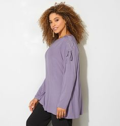 Shop tops with interesting shoulder and sleeve detail like our new plus size Lace-Up Shoulder Top available in sizes 14-32 online at avenue.com. Avenue Store