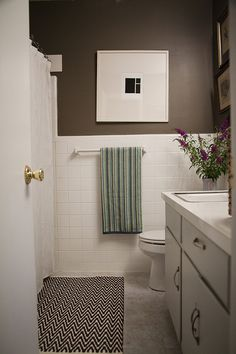 A Simple, Inexpensive Bathroom Makeover For Renters: DIYer Ellie Somerville McNevin painted the walls, put down new flooring and added a little flair to the mirror to make a huge difference in the look of her bathroom. You'll be surprised at how easy it was to do, too!
