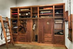 Tack room :)  shelving for saddle pads and clothes and an extra locker for friends! Perfect!