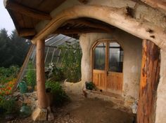 Cob house with attached greenhouse = LOVE!!