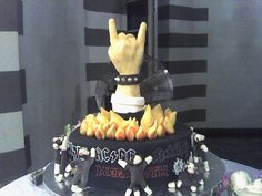 Heavy metal groom's cake? // Rockstar Wedding Cake topper -- possibly a bride & grooms hands throwing up horns, connected with wedding rings!!
