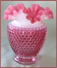 Fenton Cranberry Opalescent Hobnail Ruffled Top Vase.  My Mom kept pennies in her vase.