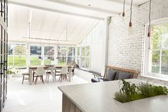 A London Home Full of Light// white kitchen, painted brick