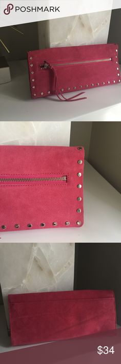 """NWT Banana Republic pink suede studded clutch Hot pink genuine leather suede clutch. Silver studs on front flap. Magnetic closure. Zipper pockets on outside and inside. Measurements: 5""""X11"""". Still has paper packaging inside. New with tags. No flaws. Reasonable offers welcome! Banana Republic Bags Clutches & Wristlets"""