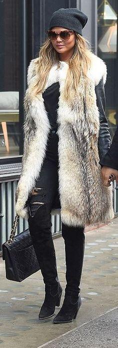 Who made Chrissy Teigen's black handbag and tan coat? Purse – Chanel  Coat – Saint Laurent