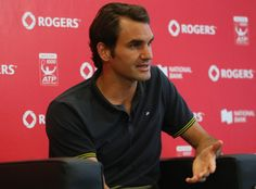 Roger Federer of Switzerland talks with the media during the Rogers Cup at Rexall Centre at York University on August 3, 2014 in Toronto, Canada.