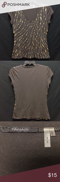 Tahiri Low V-neck Tee Bust 36 Length 23.5 . This shirt is in excellent condition. There are no rips stains or tears. There is also no piling or cracking in the paint. Material is stretchy. Tahari Tops Tees - Short Sleeve