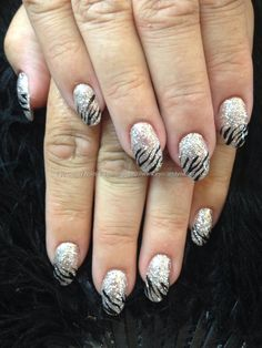 Silver glitter gels with black freehand nail art