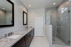 Beautiful #bathroom! A refreshing retreat by #designer Diana BakerMetalwood Argento and Platino with New Azul Aran #granite