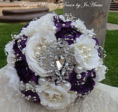 """10"""" Purple & Ivory Jewel Embellished Brooch Bouquet Simple Elegant custom designed flower bouquet in purple & ivory mix (can be made in purple & white also). Pearl brooches added to each flower center"""