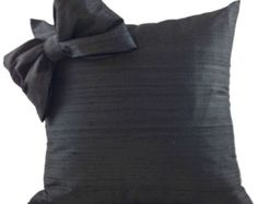 Black and white silk pillow with detachable bow has a definite feminine-vibe and works best with curved furniture pieces.  This pillow is a star in any room.  Don't be afraid to sit back and relax on it because the inside of the bow has a spongy bounce-back material.