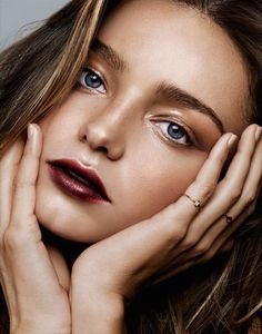 Glossy bronze eyes with a dark red lip.