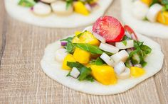 This raw vegan version of ceviche utilizes hearts of palm along with cherry tomatoes, mango, spinach, and a burst of fresh lime