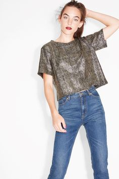 6938422e6e333d A loose, cropped party tee cut from a waffle fabric generously spangled  with metallic gold