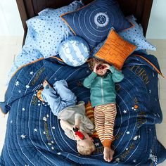 "Let the countdown to bedtime begin. The Land of Nod's out-of-this-world Solar System quilt features our eight official planets orbiting the sun. Feeling sorry for Pluto? We've paid homage to the cute dwarf planet in a top-of-the-bed, reversible throw pillow. Complete the universe with our Stars and Orion's Sheet Sets. Don't forget a ""Blast-Off"" throw pillow."