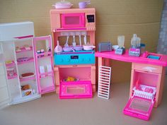 When us three were younger we had the largest collection of Barbies on the westside! Not only did we have a HUGE rubbermaid full of barbi...
