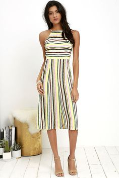 AS SEEN ON THE TODAY SHOW! With an item as unique as the Great Novelty Cream Striped Midi Jumpsuit, all your friends will wonder where you got it! Woven fabric boasts a navy blue, green, yellow, coral, and cream striped print across an apron neckline with adjustable spaghetti straps. Darted bodice and fitted waist flow into loose, pleated culottes. Hidden back zipper with clasp.