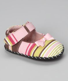 Baby's first shoes are always special, but when they're a pediped's pair, special doesn't even begin to describe them. Designed to mimic barefoot walking, these mary janes are made with durable, slip-resistant leather soles and flexible uppers, cradling Baby's feet in maximum comfort. A soft foam footbed adds a protective layer and hand-stitched seams allow tootsies to breathe. Finished with a Velcro strap, these shoes ensure every shuffle is secure.