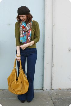 solid basic pieces, with print scarf and mustard handbag