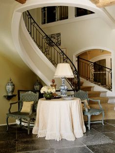 Elegant seating in the entryway, love the round table with fringe.