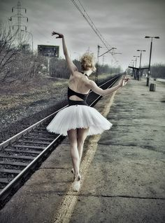 T- A senior picture like this next to the railroad tracks would be so cool for Dad!