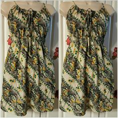 Billabong dress or blouse Cute snake skin color with yellow flowers. With 2 pockets. Can be used as a blouse or a dress. Sleeveless 100% Polyester Billabong Dresses