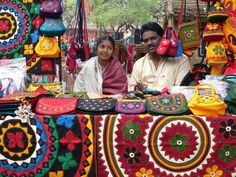 Handicrafts seller couple at a fair in Punjab, India. I was charmed by the way the wife was endearingly looking at her husband. by suz kosh, via Flickr