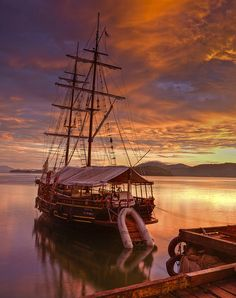 This is a photograph taken on the shores of Paraty in South East Brazil. The picture was taken at sunrise and features one of the many tourist boats that sail in these waters