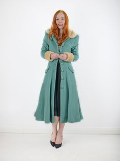 Great long coat with pockets and wide skirt