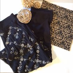 H&M pants Sheek Black/silver stone/sequins design. Great to wear on a night out! The back of pants are solid black with no stones.Good condition. Has pockets. Never worn. Wear with white tank and an nice clutch.. H&M Pants
