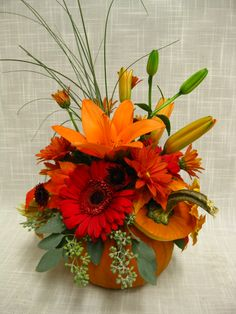 Fall wedding centerpiece inside a fresh sugar pumpkin.