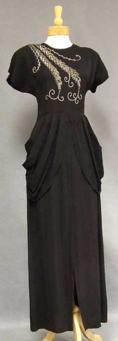 Evening Gown: 1940's, crepe trimmed with sequins and metallic braid.