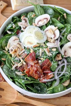 This warm spinach salad is completed with the tangy warm bacon dressing! Fresh spinach is tossed with mushrooms, bacon, almonds and parmesan cheese to create this delicious salad! Fresh Spinach Recipes, Warm Spinach Salads, Bacon Spinach Salad, Spinach Strawberry Salad, Creamy Spinach, Cheese Salad, Simple Spinach Salad, Crab Salad, Warm Bacon Dressing