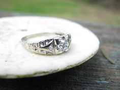 Detailed Art Deco 18K White Gold Old Mine Cut Diamond Engagement Ring, Filigree and Engraving, 1934. $600.00, via Etsy.
