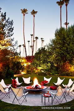 Get the Look: The Parker Hotel's Lush Landscape // Palm Springs, fire pit, butterfly chairs, palm trees