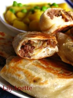 Singapore Street Food - Murtabak or Indian pancake stuffed with spiced minced mutton, onions, eggs and eaten with curry.