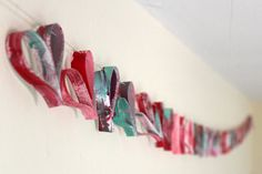 Happy and glittery hearts.  Easy garland to do with kids.