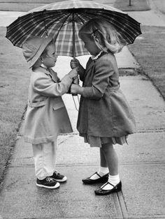 Girls Sharing an Umbrella Photographic Print