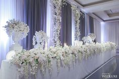 WedLuxe – A White Wisteria and Silver Sparkle Dream | Photography by LifeImages. Follow @WedLuxe for more wedding inspiration!