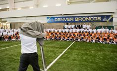 View behind-the-scenes photos of the #Broncos taking their team Super Bowl photo: