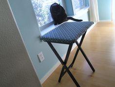 Transform a folding TV tray into a dorm-sized ironing board.